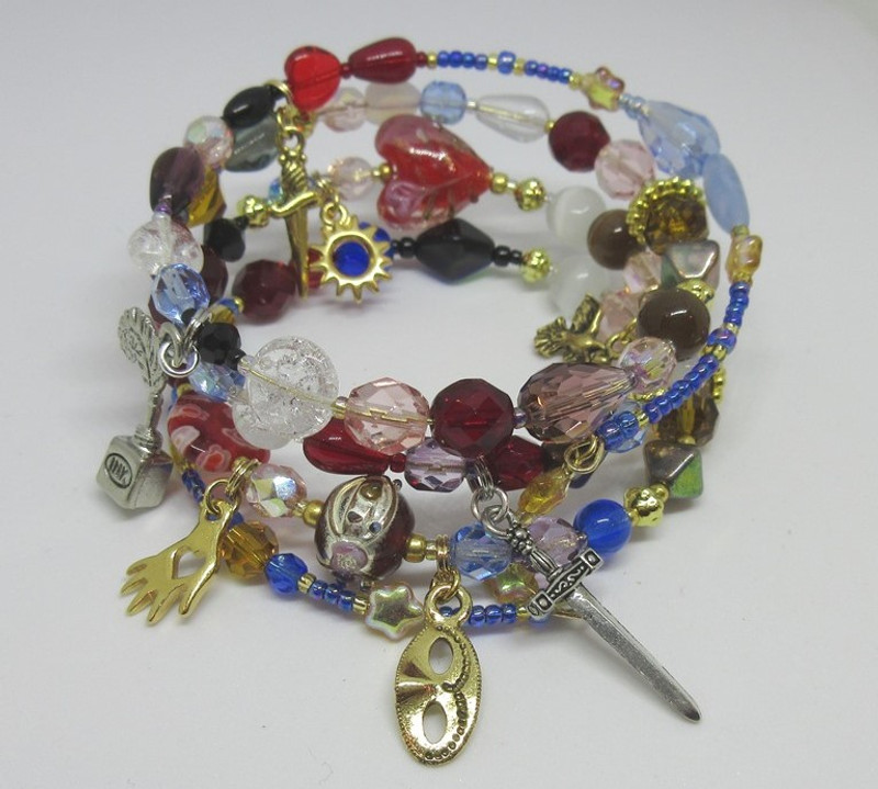 A hand evokes the initial meeting of Romeo and Juliet.  A Mask charm is the Capulet's ball.