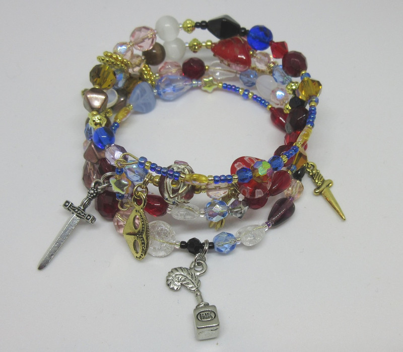 A pen and ink charm  symbolizes the message from Friar Lawrence the Romeo does not receive.