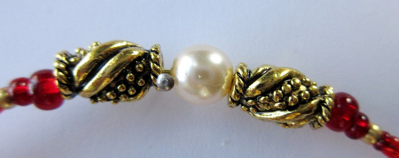 Ornate gold finished pewter beads and glass pearls enhance the Starcrossed Bracelet