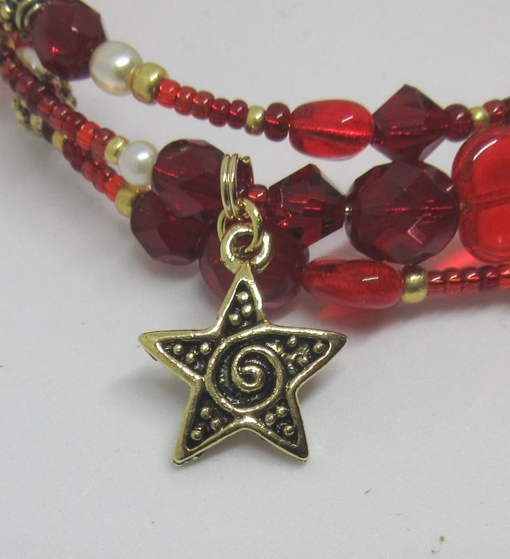 A swirly star charm represents the concept of star-crossed lovers.