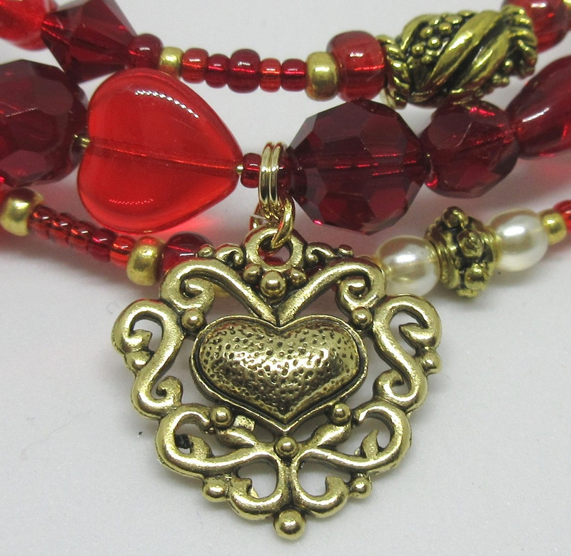 An  ornate heart charm symbolizes the love of Romeo and Juliet.