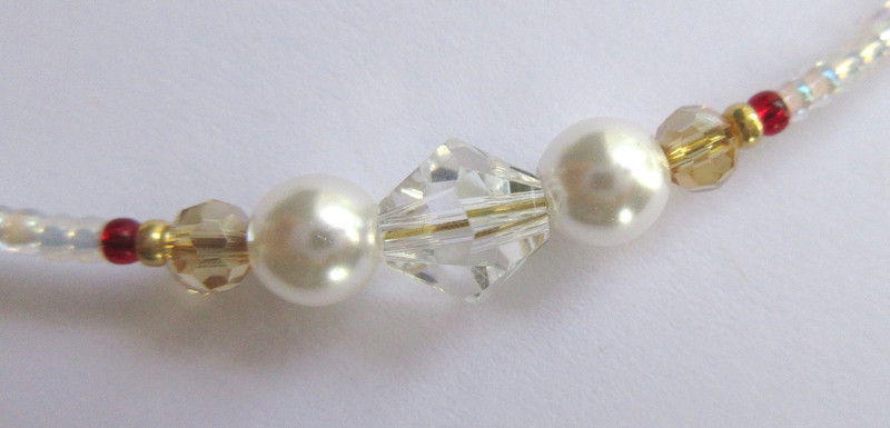 White glass pearls, heart shaped beads and clear crystals evoke the love duet in the snowstorm.