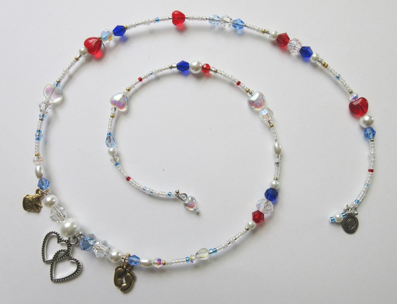 White glass pearls with touches of ruby, sapphire and cobalt beads evoke the colors of the regiment.