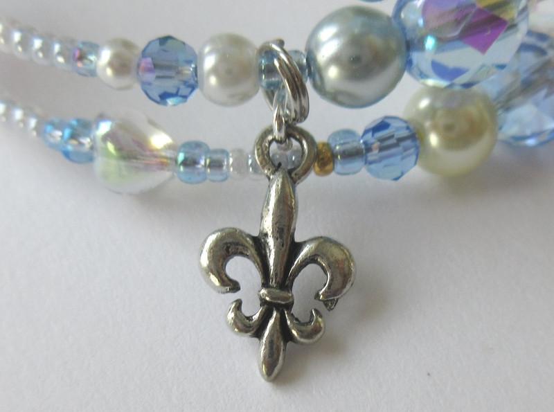 A fleur de lis charm represents the aristocratic Maddalena;