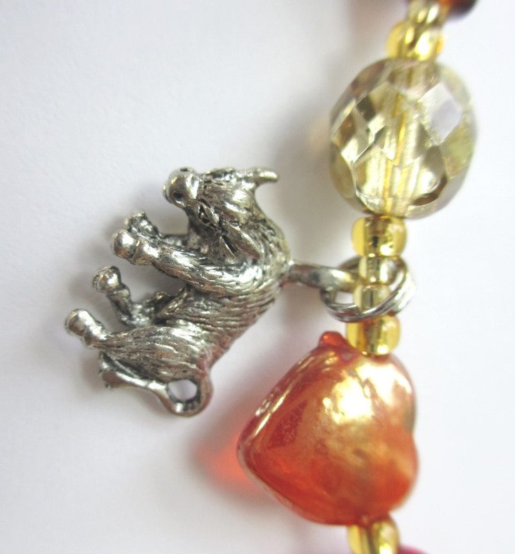 "I chose this bull charm and heart bead represent the famous aria known as ""Votre Toast"", the toreador song."