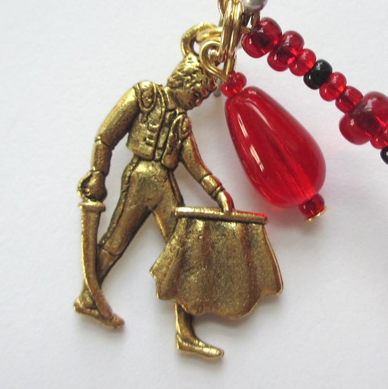 This matador charm symbolizes Escamillo in victory.