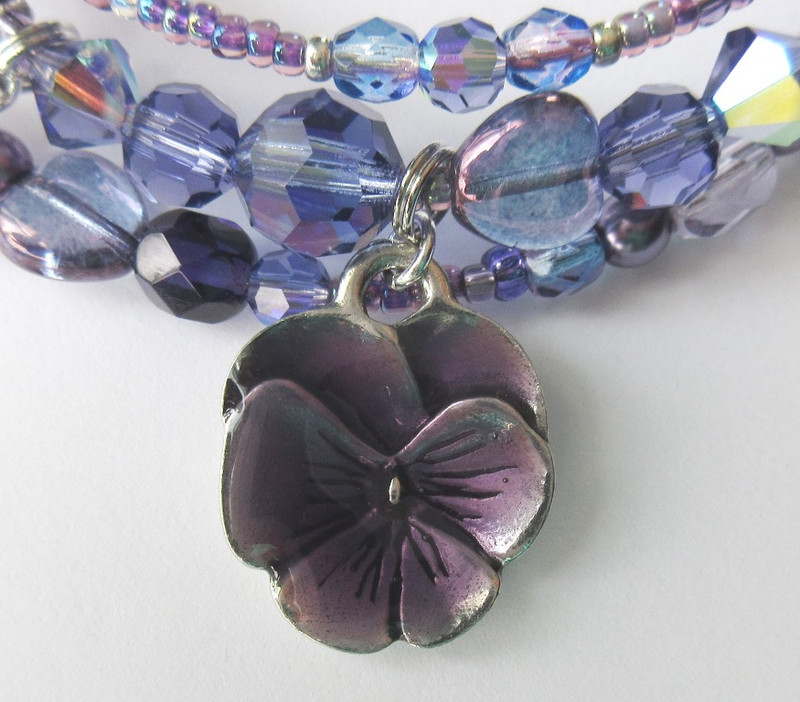 A violet charm symbolizes Adriana's affection.