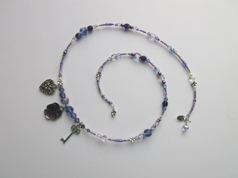Beads and crystals in shades of purple and blue-violets evoke the violets given to Maurizio by Adriana