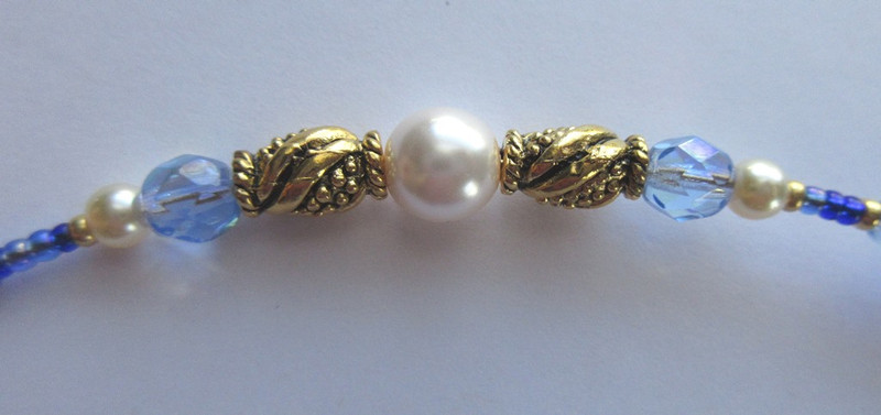 Beads represent the treasure of jewels, pearls and gold.