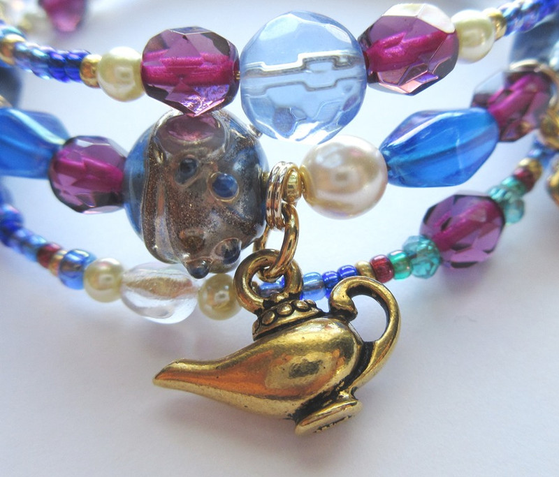 An old fashioned oil lamp charm evokes the moment Aladdin's life changes forever.