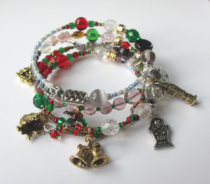 Another view of the Christmas Carol Bracelet telling the story of Dickens' beloved tale through symbolic beads and charms.