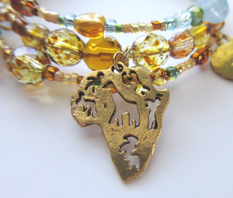 A charm represents the setting of Africa.