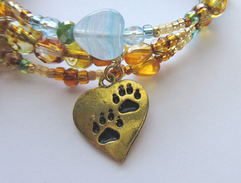 A heart with paws represents themes of love and life.
