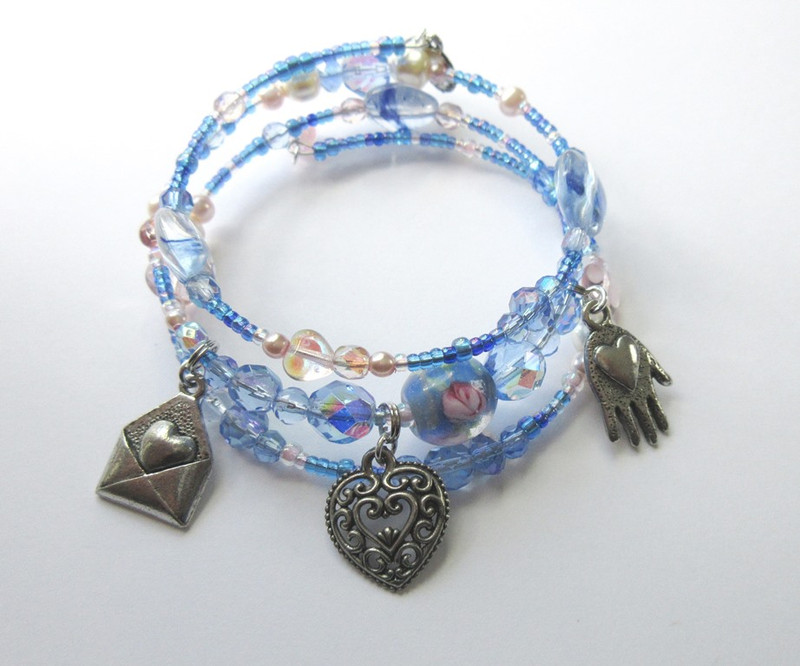 The Micaela Bracelet represents the character of Micaela from Bizet's opera Carmen.