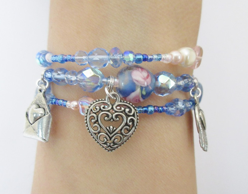 """Blue beads evoke Macaela's description as """"the girl in a blue dress"""". Touches of pink and pearl emphasize her femininity."""