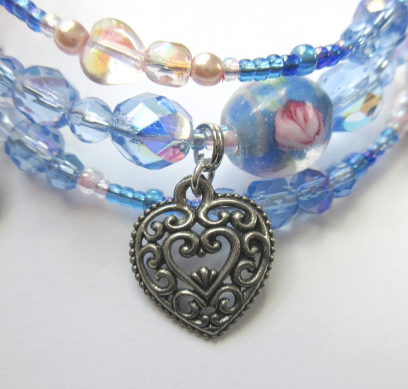 A heart charm symbolizes her love for both Jose and his mother.