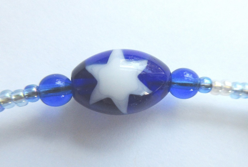 Blue and white beads evoke the exiled people of Israel.