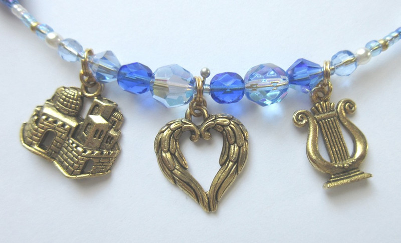 "A Jerusalem charm symbolizes the homeland of Isreal. A wing heart charm represents the words: ""Go thoughts on golden wings"". A harp charms symbolizes the words:""Golden harp of the prophets, why do you hang silent."""