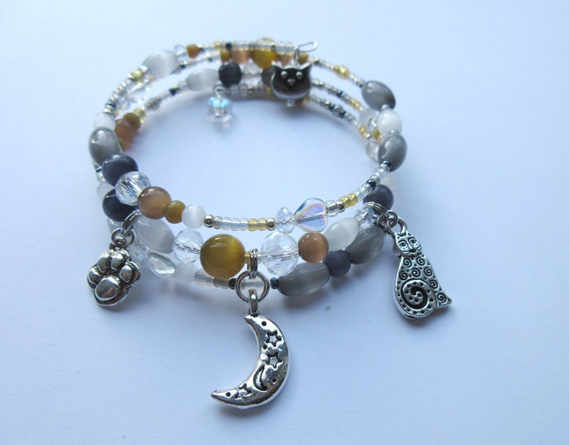 The Cat Magic Bracelet is inspired by T.S. Eliot's poems about cats, and cats in literature and theater.