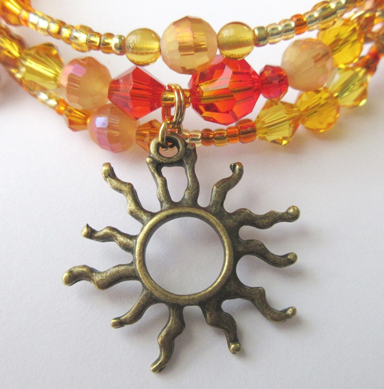 A sun charm represent the god Aten. A crystal fire-opal at the front center symbolizes the Hymn to the Sun.