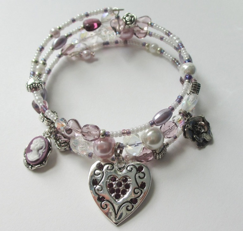 Beads and charms represent Violetta from La Traviata.