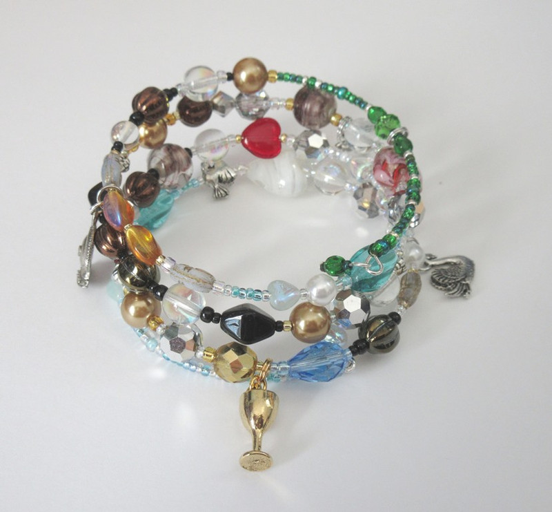 The Lohengrin Opera Bracelet tell the story of Wagner's opera. A goblet represents the Holy Grail as Lohengrin is son of the Grail King Parsifal.