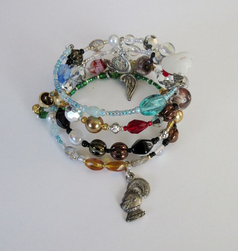 The Lohengrin Opera Bracelet tell the story of Wagner's opera.  The knight's head represents the unnamed knight.