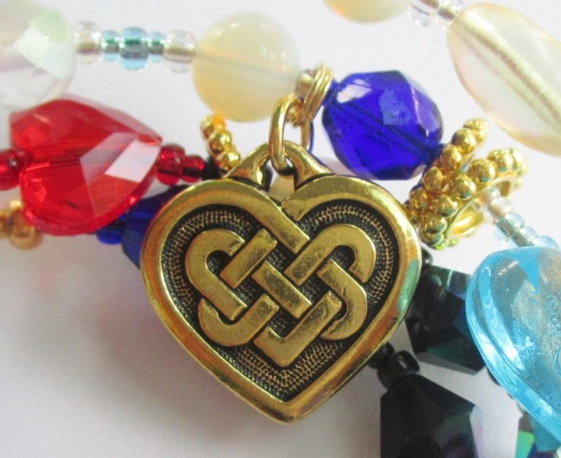Detail: Celtic heart charm.