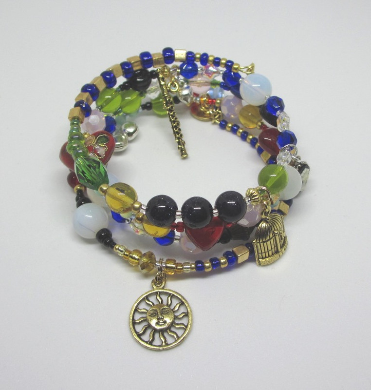 Beads and charms symbolize the story of  Die Zauberflote...