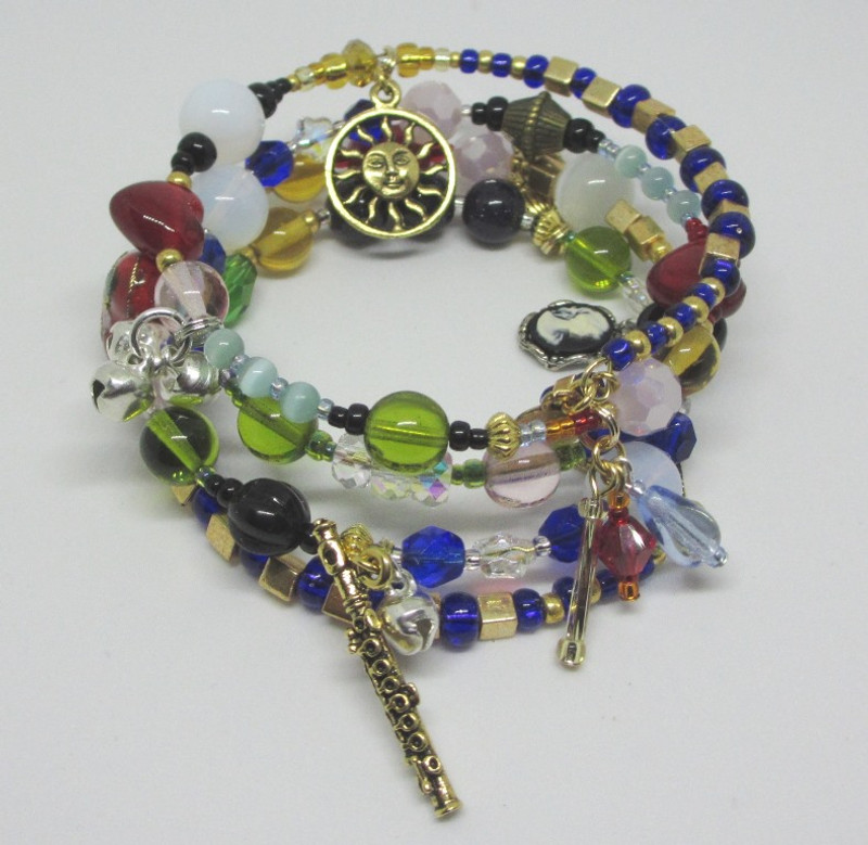 Deep blue and gold colored glass beads evoke the riches of ancient Egypt.