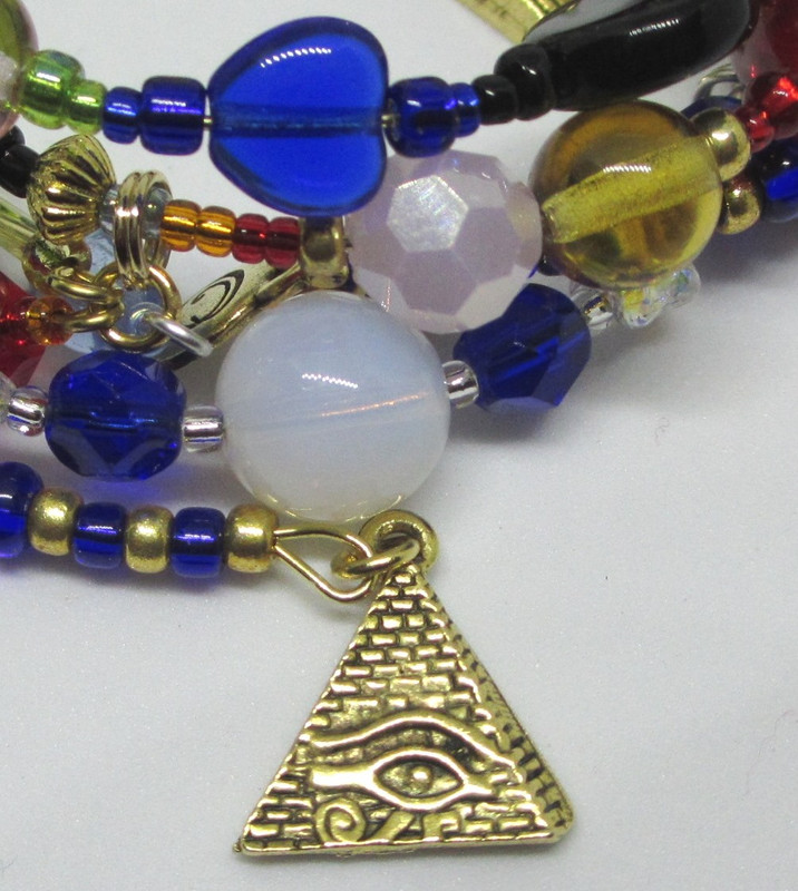 A pyramid charm evokes the setting of mystical Egypt.