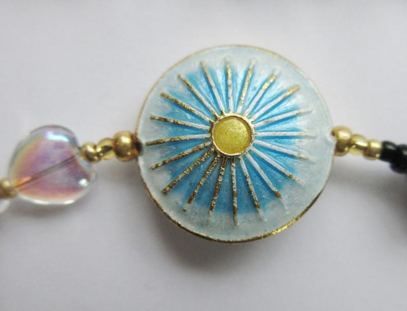 The sunburst bead symbolizes the Hallelujah Chorus.