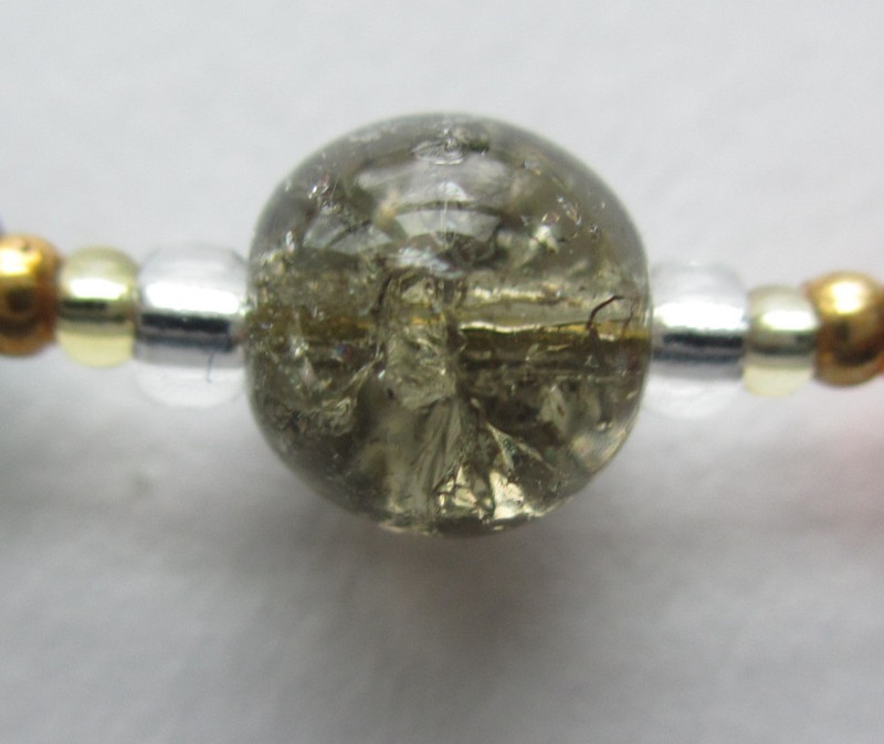 A grey bead of crackled glass symbolizes the crack of thunder - Donner the thunder god.