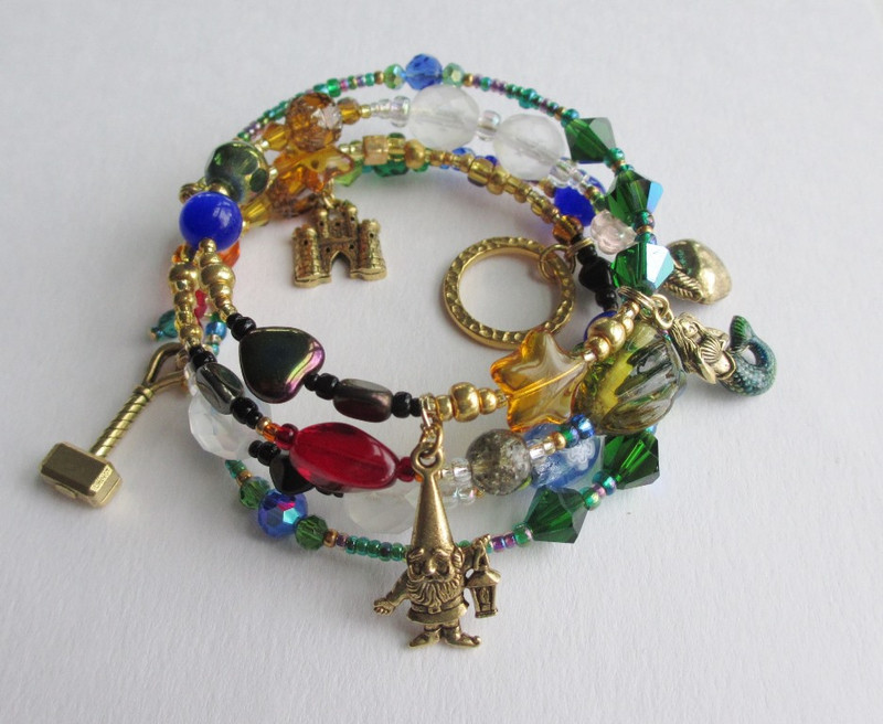 Beads and charms tell the story of Das Rheingold.