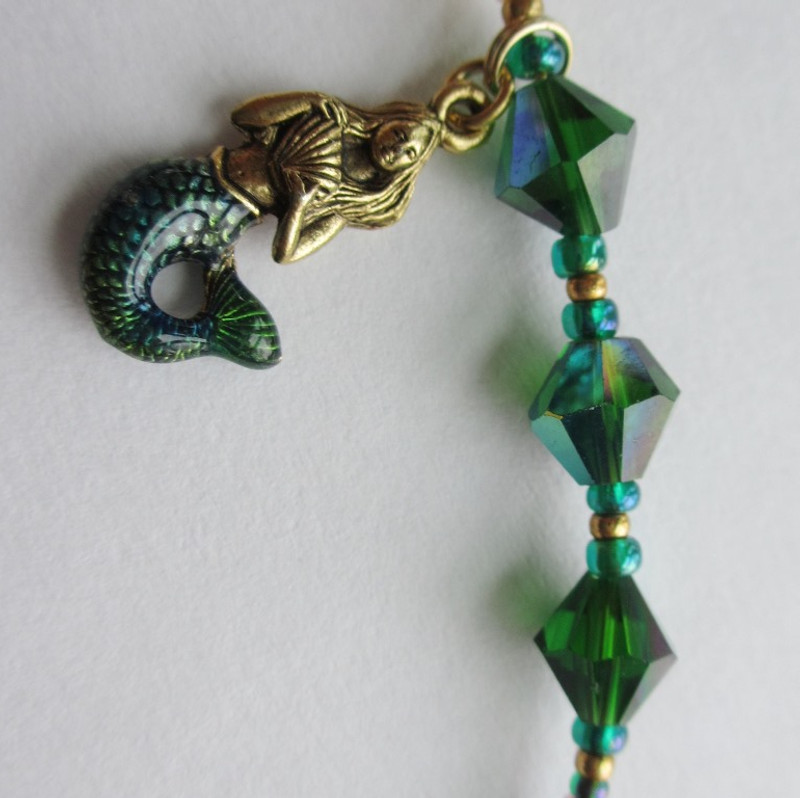 I chose three emerald beads and a mermaid charm to represent the Rhinemaidens.
