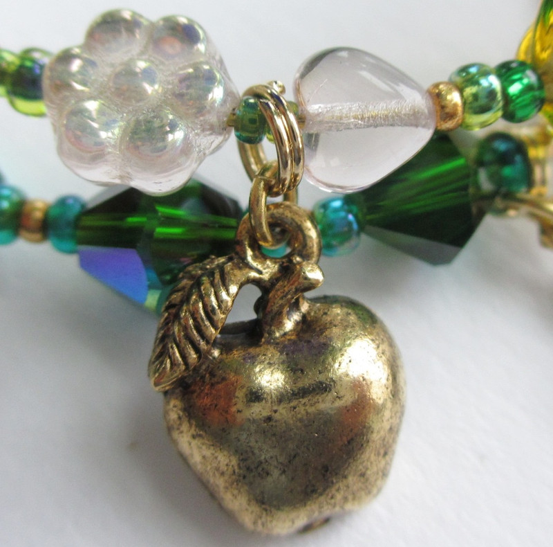 Freia, is a glass flower; a charm signifies the golden apples which bestow eternal youth.