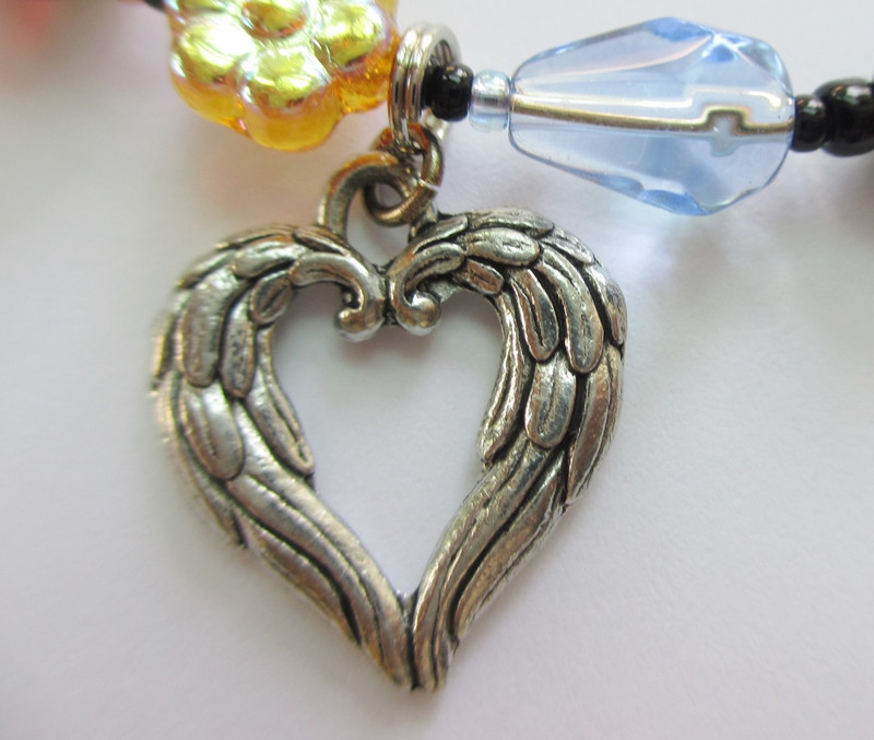 The angel wing heart symbolizes Gilda's promise to pray for her father in heaven upon her death.