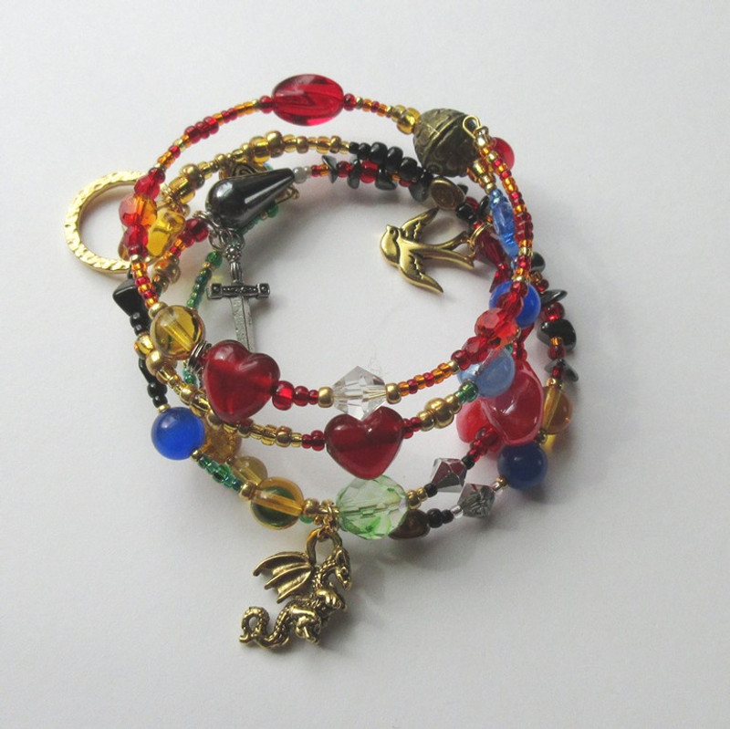 View of the Siegfried Bracelet highlighting the dragon charm.