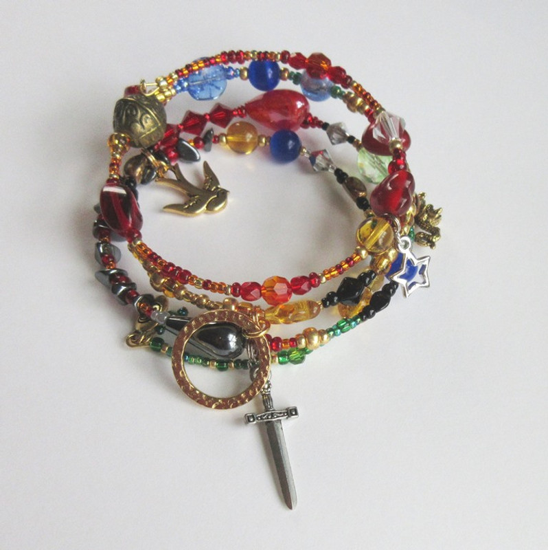 Each bead and charm represents a character, song or important moment from  Wagner's opera Siegfried, third episode in the Ring Cycle epic.