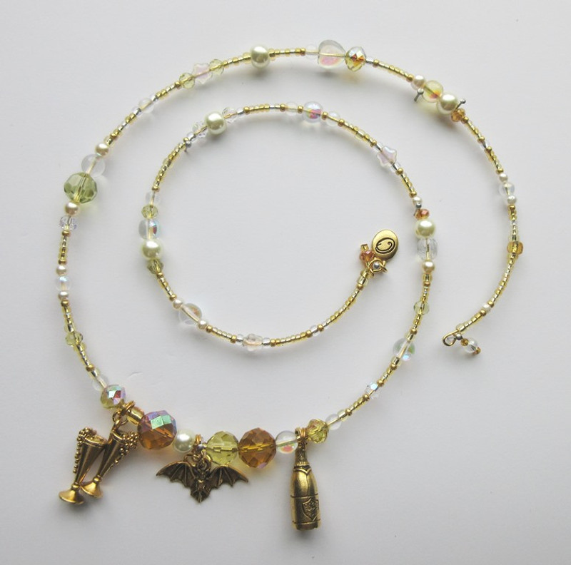 Champagne colored beads and crystals evoke Die Fledermaus.