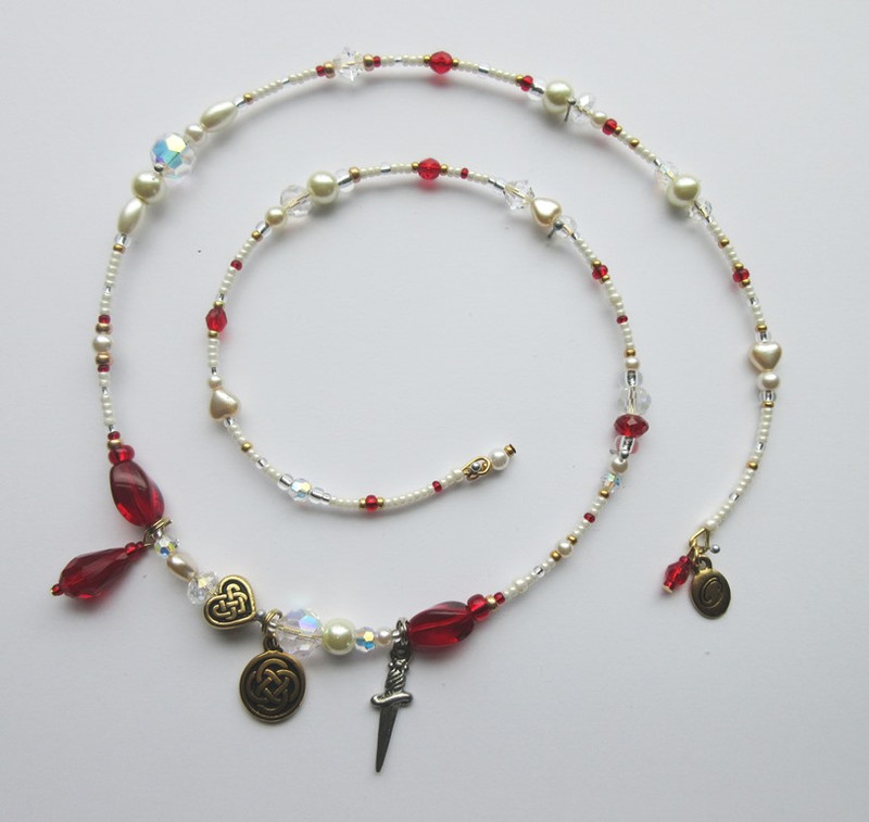 Pearl and ruby red beads represent Act 3 of Lucia di Lammermoor.