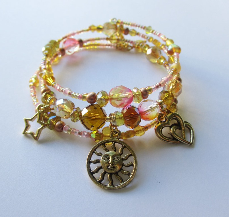"The love duet from Siegfried, inspires this bracelet composed of the colors of the dawn: ""Heil dir Sonne""."