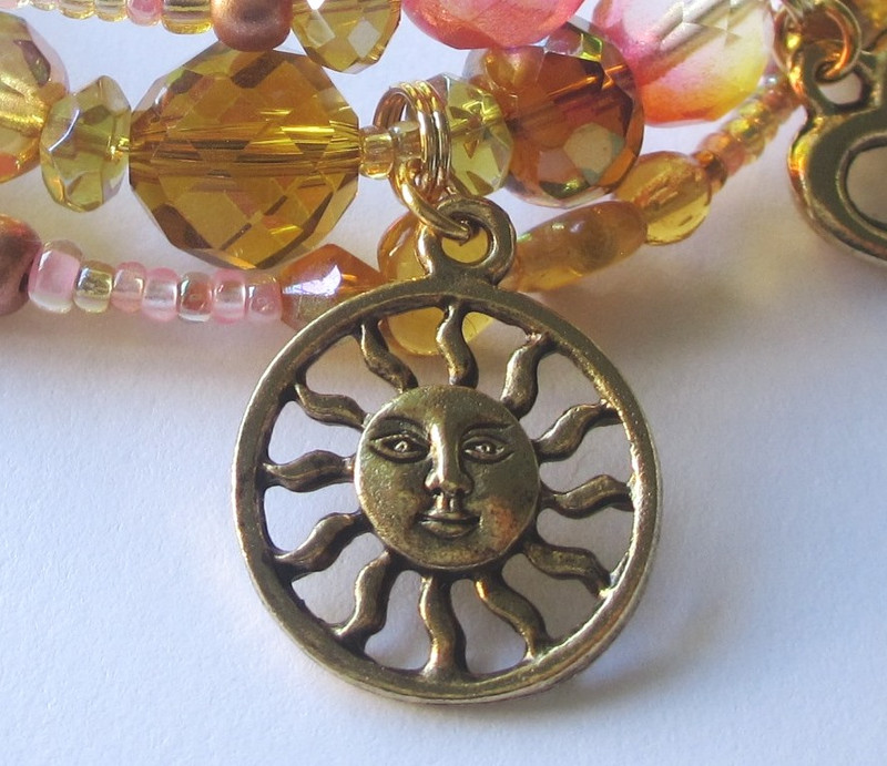 The sun charm is symbolic of Brunnhilde's greeting to the light.