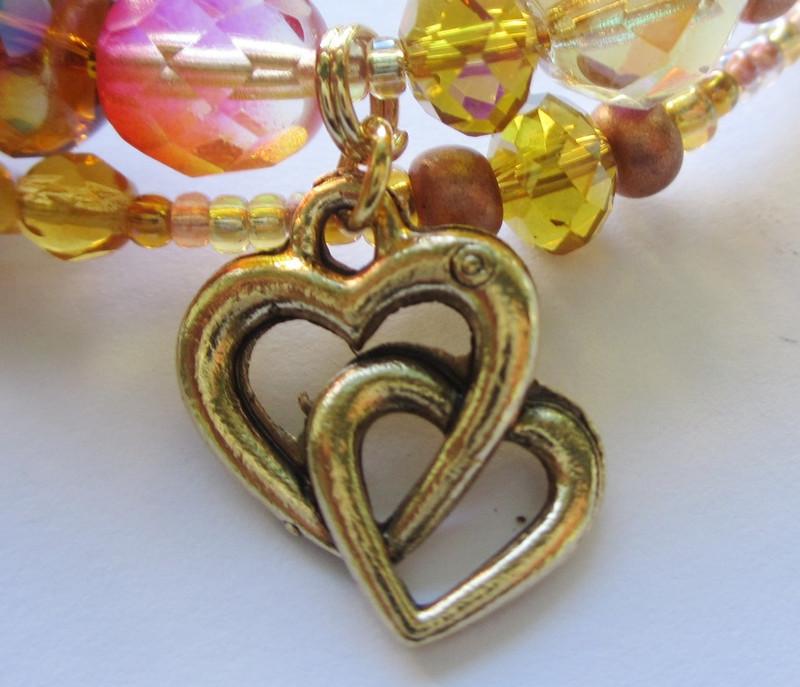 Heart and star charms evoke Siegfried and Brunnhilde's illuminating love.