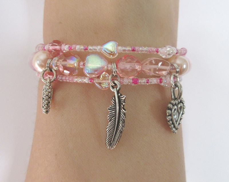 Charms on the bracelet include the flighty feather in the breeze that women are compared to and hearts indicating man's need to love women in spite of it all.