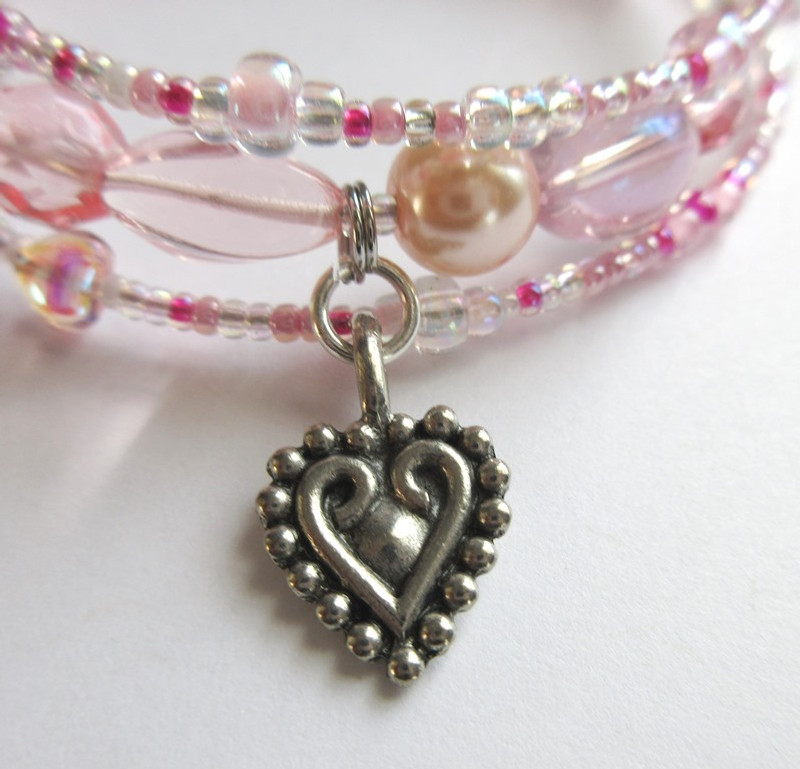 Heart charms emphasize the power of women's love through which men are strengthened or utterly undone.