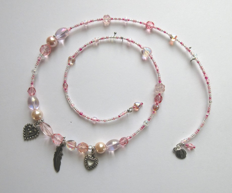 Pearl, glass and crystal beads in shades of delicate pink celebrate the subtle powers of women.