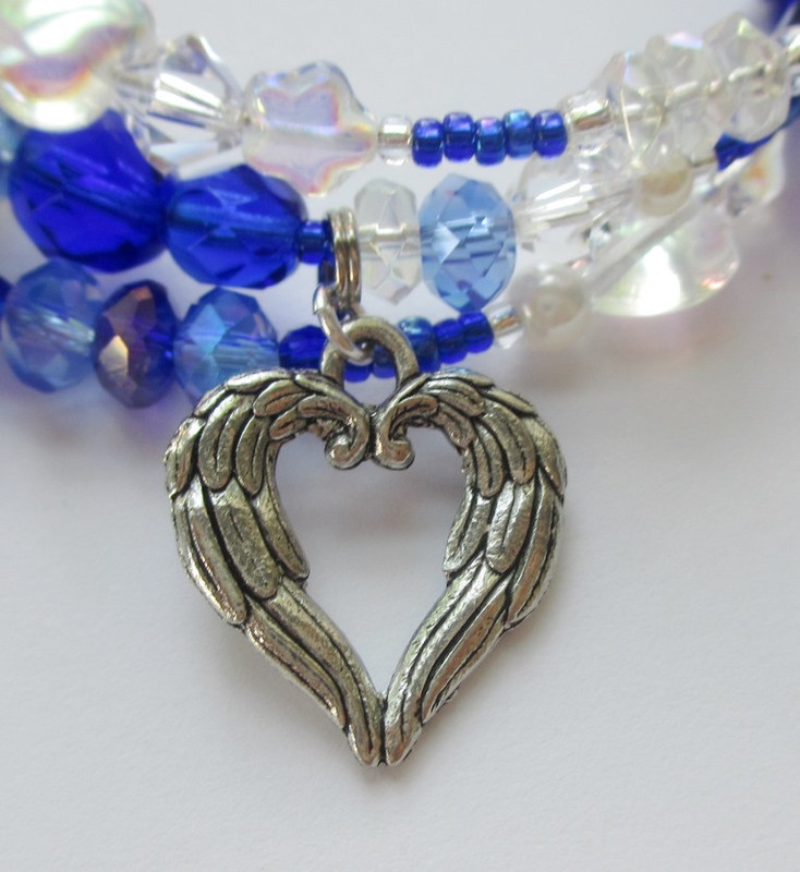 An angel wing heart represents Mimi's sad fate and Musetta's words... that Mimi is an angel who doesn't deserve to die... (pass the kleenex please).