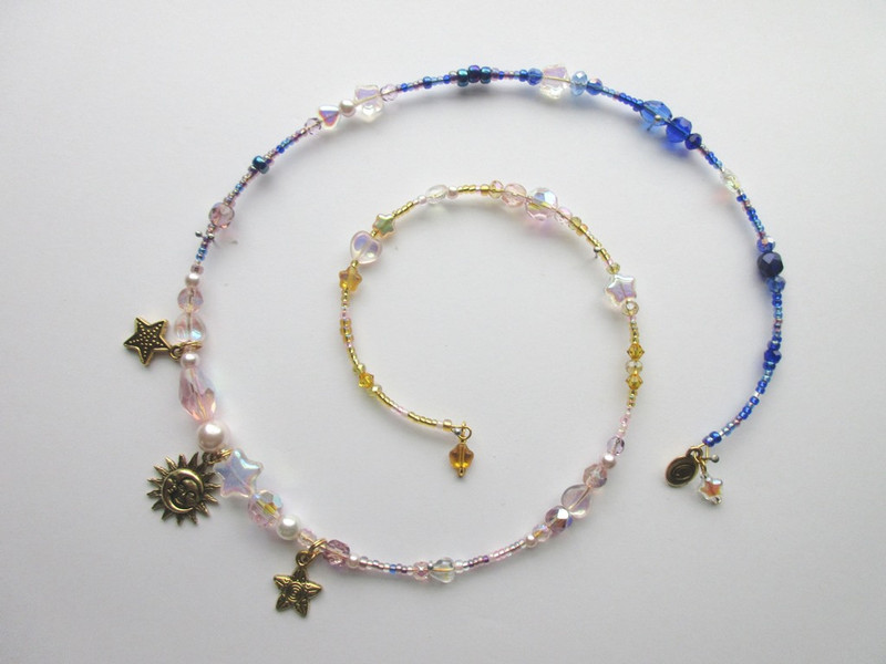 The colors of the beads on this bracelet symbolize Calaf's vigil: deep blues and purples indicate the night which blend to pinks and golds representing the dawn.