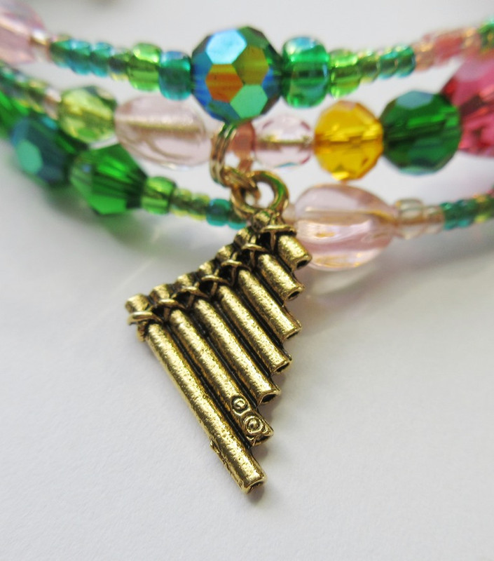 Another charm on the bracelet is Papageno's flute with which he calls to the birds.